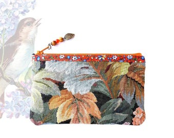 Small cosmetic case in multicolor floral fabric