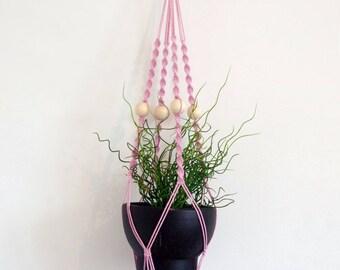 Pink macrame hanging planter