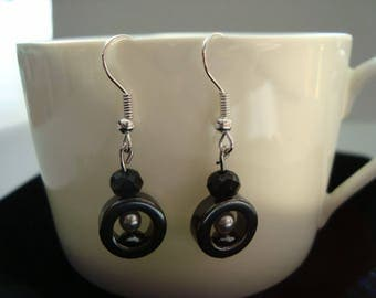 Earrings with hematite and black faceted glass beads