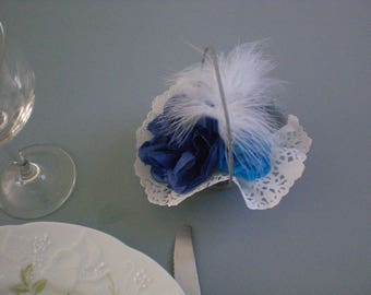 Small basket of flowers and blue feathers