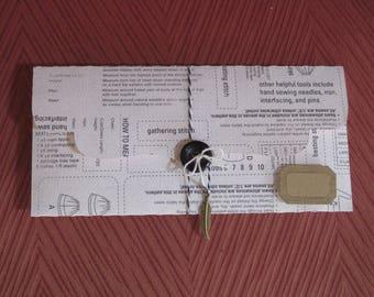Gift bag, tickets, writing, sewing, kraft tag