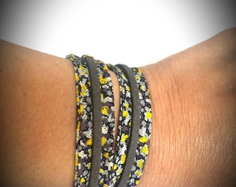 Bracelet obliquely and gray suede cord