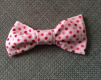 With pink polka dot bow hair clip