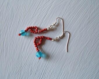 Coral earrings in blue ocean