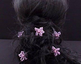 A light purple flower hair pins