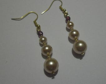 Dangling earrings with Swarovsky crystal peach pearl beads