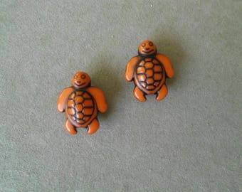 2 turtles orange acrylic beads