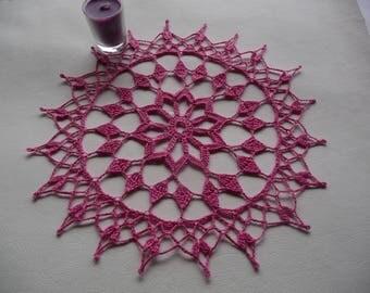 Handmade fuchsia cotton crochet lace doily.