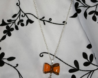 Macaron necklace and a knot in fimo