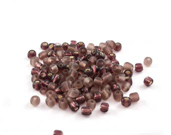 Mix of large purple seed beads purple toned glass 4mm, 10 grams (approximately 110 beads)