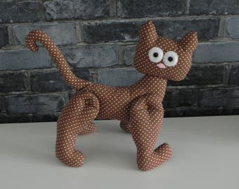 Brown cat with articulated white dots