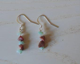 a pair of Silver earrings and stones gems.