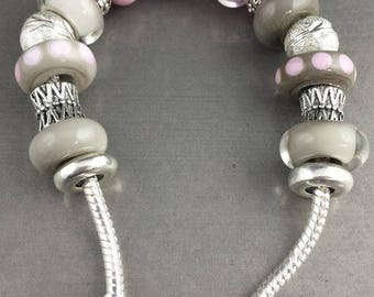 Bracelet made of glass in shades of PINKS and grays. Lampwork Glass Beads