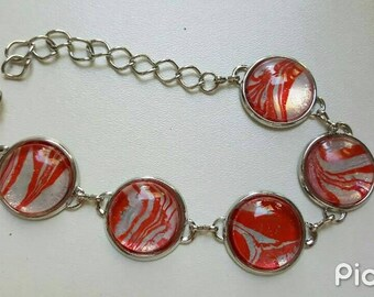 Painted red and white bracelet with 5 glass cabochons
