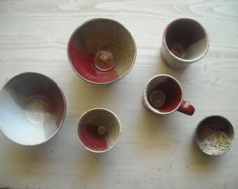 Handmade stoneware pottery with cranberry glaze