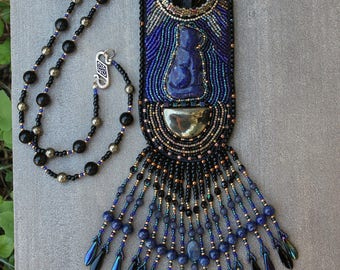 BASTET, blue and gold necklace with lapis lazuli, pyrite and Obsidian Celestial Eye beads