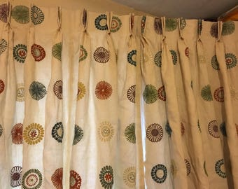 Double pleated lined curtain