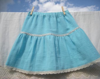 Girl in blue seersucker skirt
