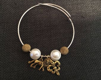 Lion Up! Metal bracelet with pearl accents