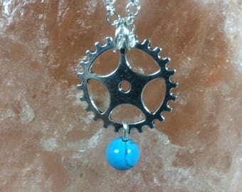 Steampunk pendant with silver plated chain and turquoise dyed magnesite bead