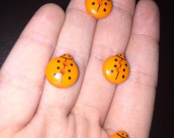 Set of 7 lovely vibrant orange ladybird buttons