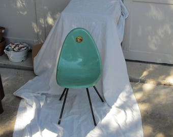 Herman Miller Shell Chair- Childrens   green in color