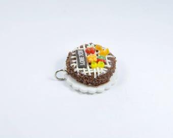 fruit and 1 chocolate cake charm