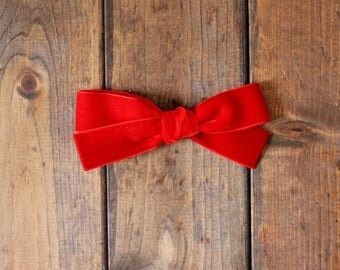 Hand tied red velvet bow for babies, toddlers and little girls on clip or nude nylon headband. JANIE style