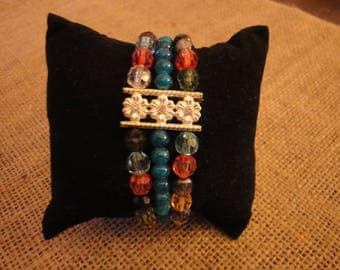 FACETED GLASS BEAD and silver stretch bracelet multi-coloured