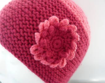 Knitted by hand with flower