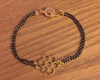 Chain bracelet black gold beads