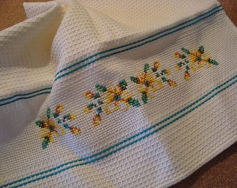 Towel embroidered in cross stitch