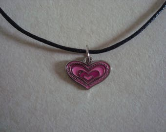 Necklace pendant with a heart in shades of pink