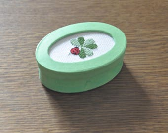 green box with Ladybug and clover