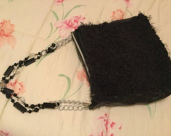 Wool bag with leather inserts