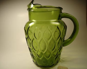 Green glass tall drinking pitcher