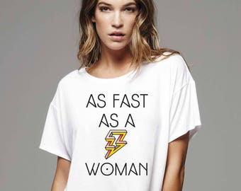 As Fast as a Woman T-shirt. Available on men's and women's sizes. Printed on a comfy Bella Canvas t-shirt.