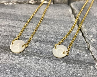 Mother Pearl round Initial Chocker. Could be made an inch longer upon request. All initials available