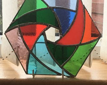 Hexagonal pinwheel stained glass