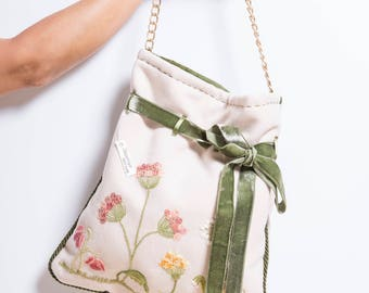 Hand embroidered cloth bag with velvet ribbon
