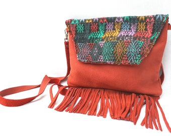 Woman with red fringe leather bag