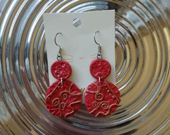 Dangling earrings with red circles