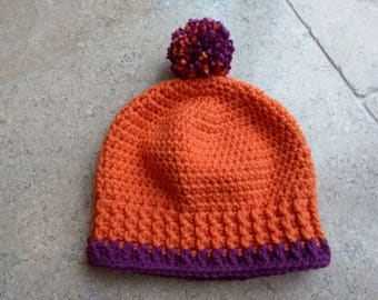 Hand crocheted beanie hat with pompom