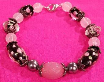 Rose Quartz and Black Beads with Roses Bracelet.