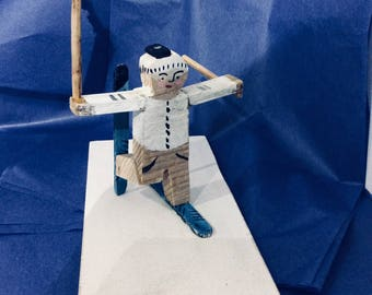 Wooden Skier, one ski up