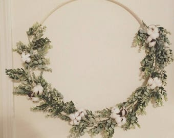 Simple wooden and greenery wreath