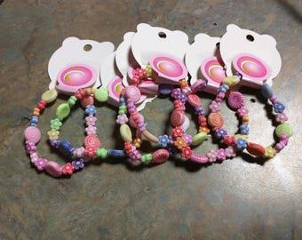 Child size stretch beaded bracelet fun Multi colored Flowers