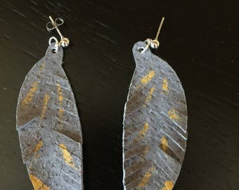 Gray genuine leather feather earrings.