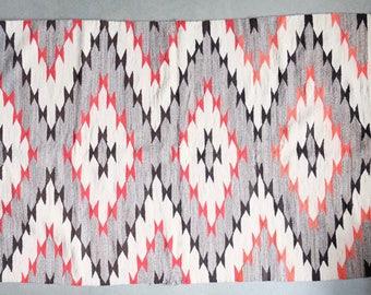 Antique Navajo eyedazzler rug