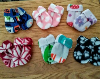 Mittens for baby (thumbless) your choice of one pair.